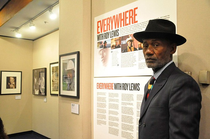 "Roy Lewis, photographer, stands beside his ""Everywhere with Roy Lewis"" exhibit at Jackson State University in April 2019. Photo courtesy Roy Lewis"