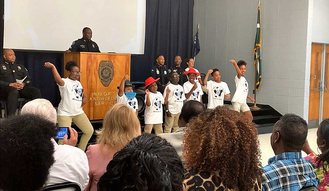"Youth from the Jackson Police Department Youth Citizens Police Academy dance to Lil Nas X's ""Old Town Road"", their class theme song, at their graduation ceremony on June 21. Photo by Shikira Porter"
