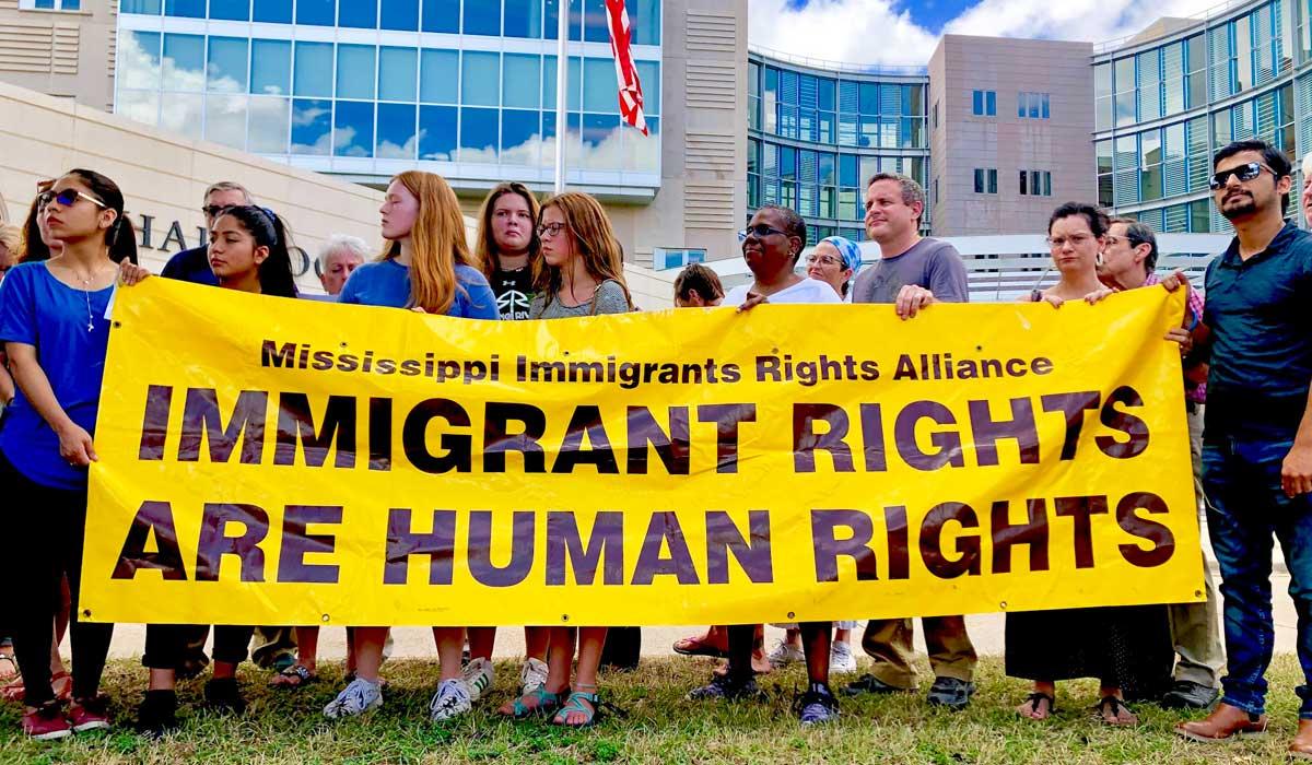 'Horrified' Activists Rally Against Natchez Migrant Facility
