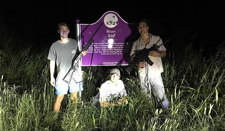 Three University of Mississippi students posed with rifles for a photo next to the bullet-riddled Emmett Till Marker in Tallahatchie County. They posted it on Instagram. Photo courtesy Instagram vis MCIR
