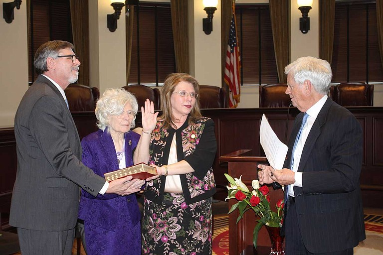Donna Barnes (center) at her swearing in ceremony. With Judge Barnes at left are her brother Paul Barnes and mother Ouida Barnes. At right is Supreme Court Chief Justice Mike Randolph, who administered the oath. Photo courtesy Mississippi Courts