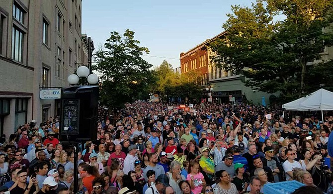 "Hundreds of people, mostly young adults, stood shoulder-to shoulder Sunday night at a vigil and vented their frustration at the Republican governor, interrupting him with chants of ""Make a change!"" and ""Do something!"" as he talked about the victims. Photo courtesy Dayton, Ohio Facebook"