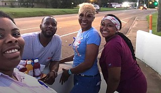 The family of Cedric Willis joined a deep conversation about preventing violence at Walton Elementary School on Aug. 1. Pictured from left: Youth Media Project organizer Leslyn Smith, Ryan Willis, Alana Willis and Josalyn Johnson. Photo courtesy Leslyn Smith