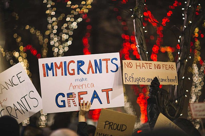 """""""Perhaps most importantly, we can set an example of what America really is. We can use our own voices to call for a humane immigration system and use our resources to support members of our communities who were attacked today. We can be the America we know we can be."""" Photo by Nitish Meena on Unsplash"""