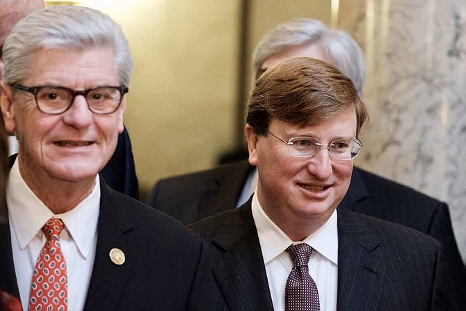 Mississippi Gov. Phil Bryant (left), a Republican, and Lt. Gov. Tate Reeves (right), the frontrunner to become the GOP nominee for governor later this month, have both tweeted full support for ICE and U.S. Attorney Mike Hurst for their workplace immigrant raids across Mississippi on Aug. 7. File photo.