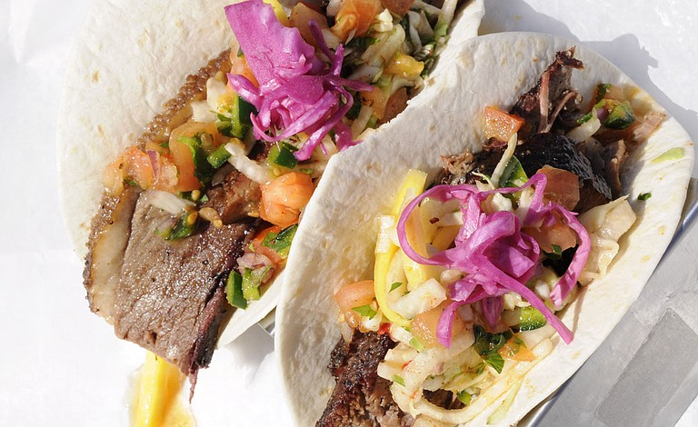 With trivia nights on Mondays at The Pig & Pint, people can both answer questions and compete for prizes, and eat some of the restaurant's dishes, including brisket tacos. Photo by Trip Burns/File Photo