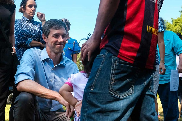 At a stop in Canton, Miss., Democratic presidential candidate Beto O'Rourke speaks with a little girl whose mother was taken in an ICE raid in town the week before. Her father, who has two other children, said ICE is still holding his wife at a facility two hours away. Photo by Ashton Pittman