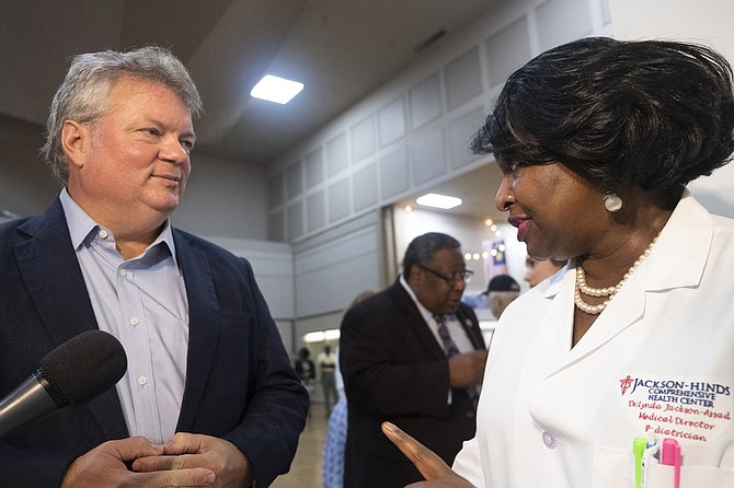 Jim Hood, the Democratic nominee for governor, speaks with Dr. Lynda Jackson-Assad following a press conference at the Jackson Medical Mall on Aug. 28, 2019. Hood stressed the importance of health-care reform for Mississippians in his remarks. Photo by Seyma Bayram