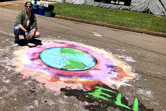 Eli Childers has created chalk art for businesses and events such as Vibe Fest in April. Photo courtesy Eli Childers