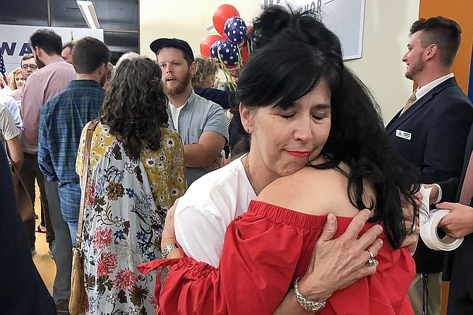 Tammy Pearson comforted friend Kay Holmes in downtown Jackson after their candidate, Bill Waller Jr., lost the GOP runoff for governor. Photo by Seyma Bayram