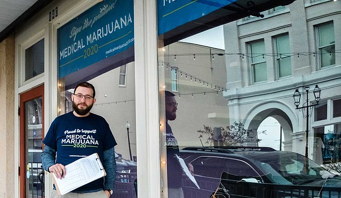 Jonathan Brown, who is heading Mississippi's Medical Marijuana 2020 signature drive, and activist Ashley Durval registered the initiative last year. The group has turned in more than 105,000 signatures to get the initiative on the ballot next year. Photo by Ashton Pittman