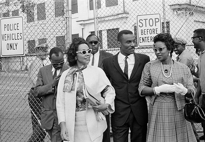 In this April 18, 1963 file photo, Coretta Scott King, left, the Rev. Fred L. Shuttlesworth, center, and Mrs. Juanita Abernathy, leave Birmingham jail after visiting Rev. Martin Luther King, Jr. and Rev. Dr. Ralph Abernathy in Birmingham, Ala. Juanita Abernathy, who wrote the business plan for the 1955 Montgomery Bus Boycott and took other influential steps in helping to build the American civil rights movement, has died. She was 88. Family spokesman James Peterson confirmed Abernathy died Thursday, Sept. 12, 2019, at Piedmont Hospital in Atlanta following complications from a stroke. (AP Photo/File)