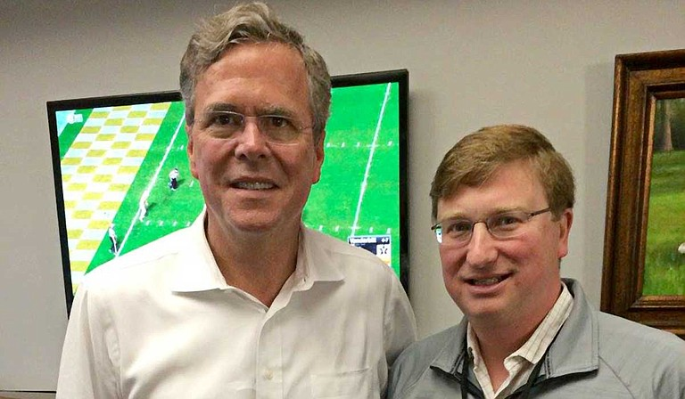 Former Florida Gov. Jeb Bush (left), seen here with Lt. Gov. Tate Reeves (right) at a Mississippi State University game in 2015, is coming to the state next month to help the Republican nominee raise money in his bid for governor. Photo courtesy Jeb Bush/Facebook