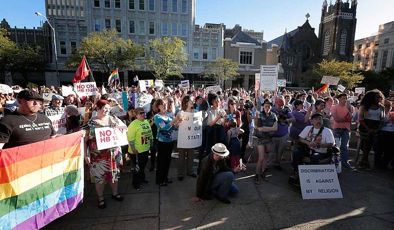"Hundreds of activists gathered outside the governor's mansion in downtown Jackson in April 2016 to protest Mississippi's ""religious liberty"" law, H.B. 1523, which granted business owners the right to discriminate against LGBT people based on religious beliefs or ""moral convictions."" Photo by Imani Khayyam"