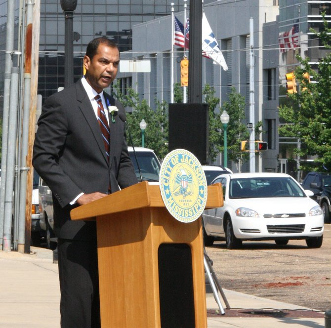 FBI Special Agent Daniel McMullen speaks to the crowd at a ceremony Tuesday honoring fallen police officers outside.