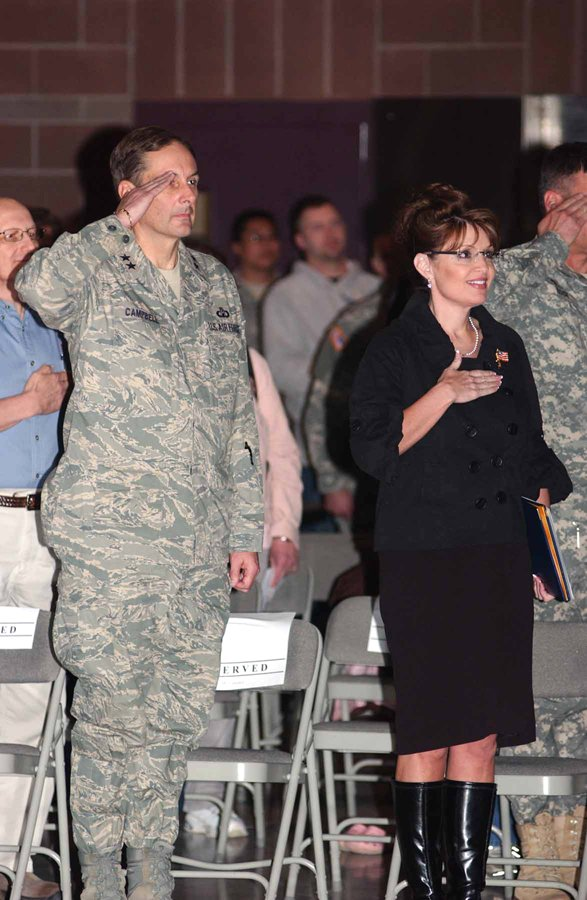 Alaska Gov. Sarah Palin salutes during the playing of the National Anthem at the official homecoming ceremony for Bravo Company, 297th Support Battalion at Fort Richardson on May 1.