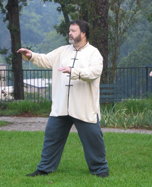 Taiji instructor Stanley Graham leads a Saturday morning group practice in a garden on Ridgewood Road in Jackson.