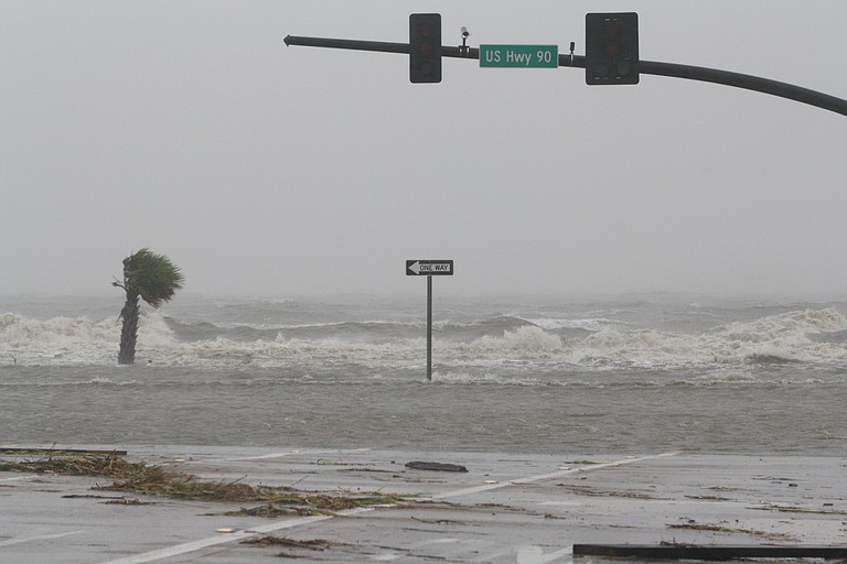 Gulf waters flood a portion of Highway 90 in Biloxi late Wednesday morning.