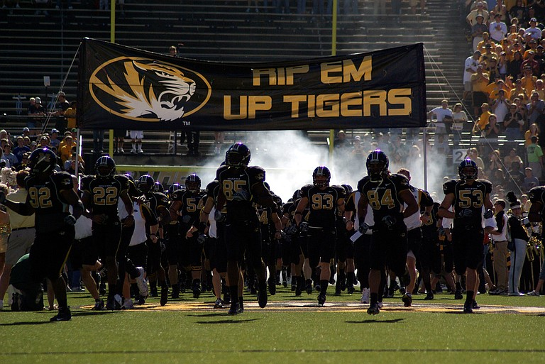 Some black football players at the University of Missouri are joining protests over racist incidents on the Columbia campus.