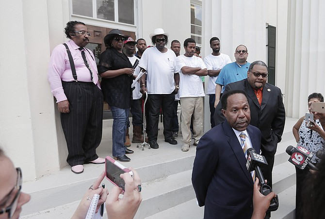 Attorney Robert Gibbs and his client Marcus Wallace of MAC & Associates address reporters outside Jackson City Hall soon after filing their lawsuit against Siemens in Hinds County Circuit Court.