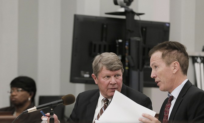 The jury is deliberating whether Downtown Jackson Partners President Ben Allen (left) is guilty or innocent of embezzling public funds. He is seen here talking with one of his attorneys, Merrida Coxwell (right).