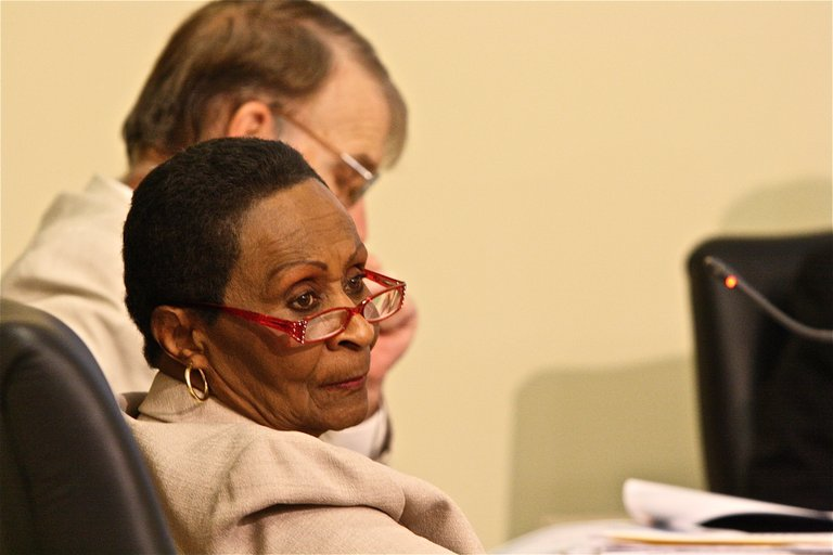JPS board member Kisiah Nolan listens to a Jackson resident during the Board's public hearing on the school budget Tuesday.
