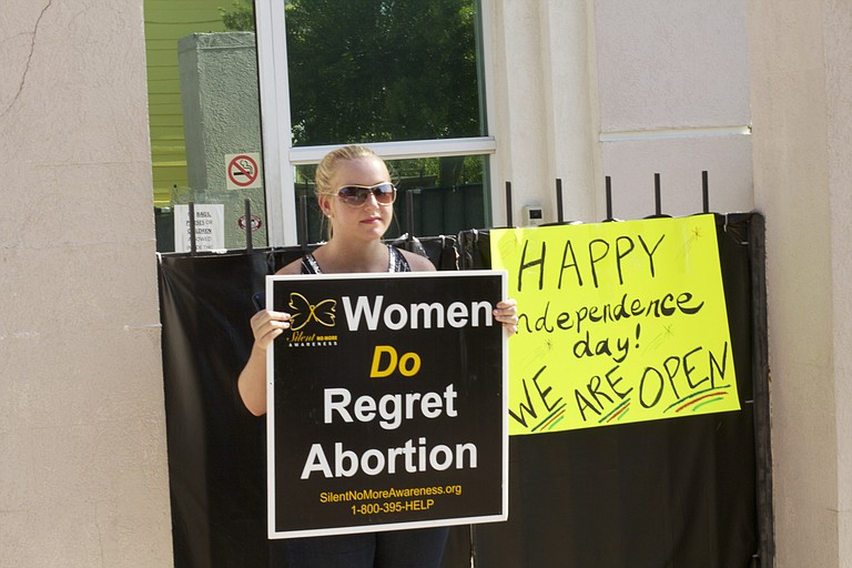 July 2, 2012: Outside the Jackson Women's Health Organization, protester Ashley Sigrest talked about her own abortion and how she now counsels other women who have gotten and regretted their abortions.