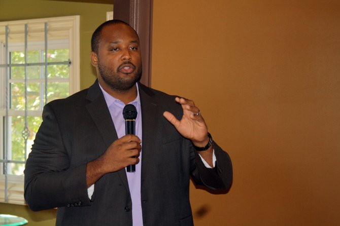 Corey Wiggins, project manager for MHAP, talked to citizens at Koinonia Coffee House Friday about the aspects of the Affordable Care Act that will soon take effect.