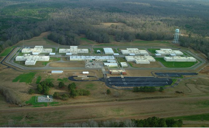 A Federal Bureau of Investigations report about the cause of a May riot at a privately run federal prison in Natchez refutes initial reports that a gang fight sparked the melee.