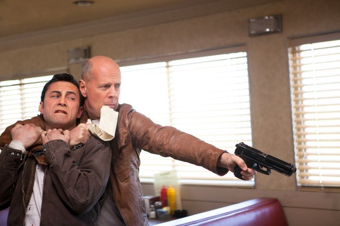 """Joseph Gordon-Levitt and Bruce Willis are captivating as young and old versions of the same character in """"Looper."""""""