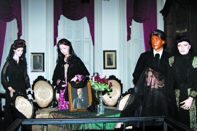 Antique dolls stand vigil in Merrehope Mansion in Meridian.