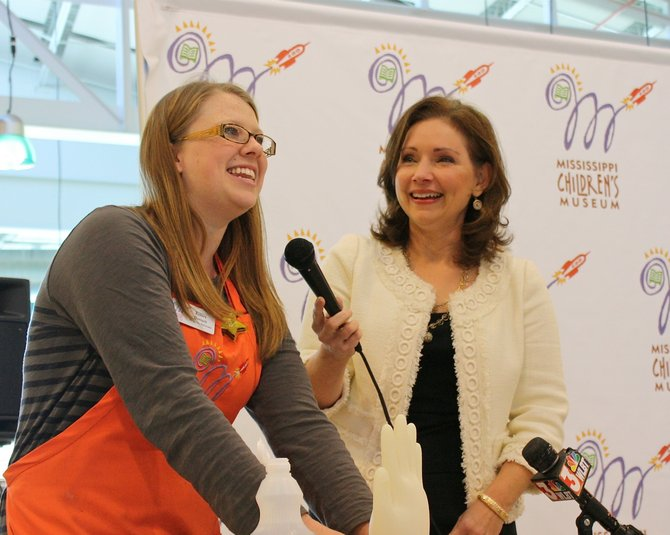 Kelsey Barnett, left, and Susan Garrard demonstrate one of the activities children will take part in at the Children's Museum's Question It? Discover It! Saturdays.