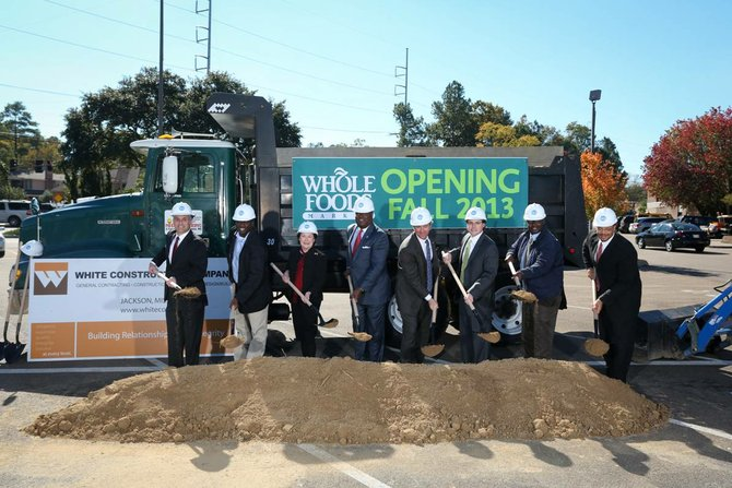 (From Left to Right:) WS Development Vice President Lou Masiello, Whole Foods Market South Region President Omar Gaye, City Councilwoman Margaret C. Barrett-Simon, Mayor Harvey Johnson Jr., Jackson city Councilman Quentin Whitwell, Highland Village General Manager Guy Boyll III, Jackson city site-plan review Coordinator Joseph Warnsley and city Director of Planning and development Bennie Hopkins break ground on the new Whole Foods Market at Highland Village Thursday.
