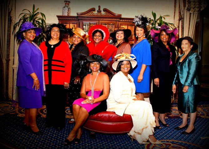 The women of the Top Hat Brunch show off their headwear. Back row, left to right: Terryce Walker, Gloria Johnson, Sonia Carter, Rita Wray, Lenora Lewis, Katrina Myricks, Wauline Carter and Ethel Gibson; seated: Sharolyn Smith, 2012 Holiday Top Hat chairwoman, and Belinda Arnold Fields, President of the National Coalition of 100 Black Women, central Mississippi chapter.