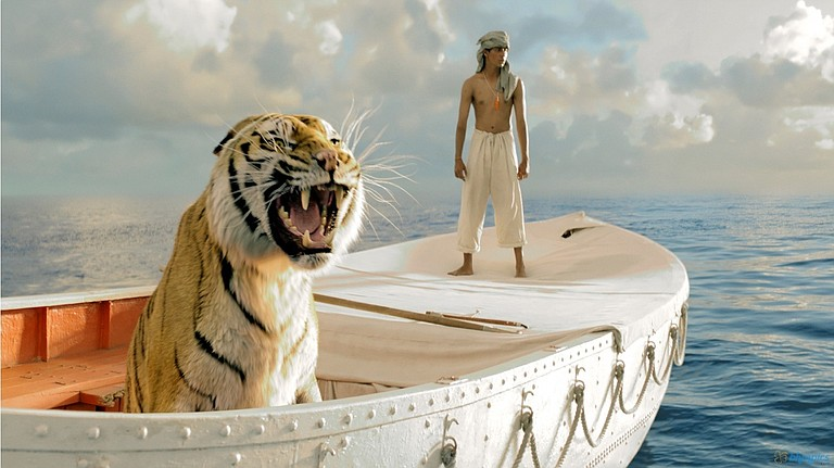 """In """"Life of Pi,"""" a tiger named Richard Parker and 16-year-old Pi (Irfan Kahn) struggle to survive—and coexist—on a lifeboat."""