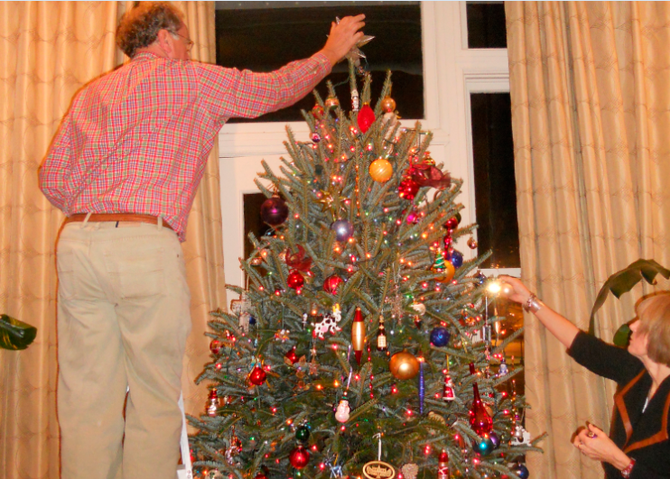 Over the past few years, helping decorate Mike McRee's Christmas tree has become an annual event for my downtown family.