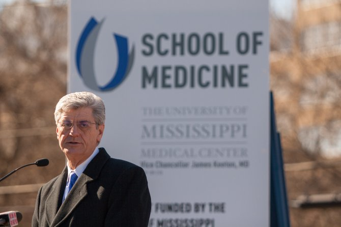 Gov. Phil Bryant says the new University of Mississippi School of Medicine could create 19,000 new jobs and generate $1.7 billion in economic impact by 2025.