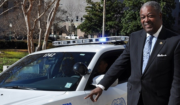 Mayor Harvey Johnson Jr. unveiled six police cars painted with Crime Stoppers logos and numbers Wednesday.