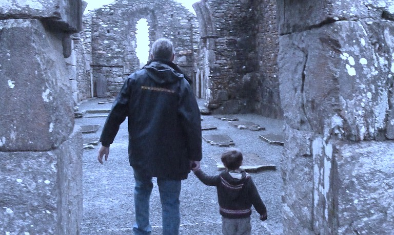 Ireland is a place for educational exploration. Here, the writer's son explores an ancient monastery in the valley of Glendalough with a Wild Wicklow Tours guide.