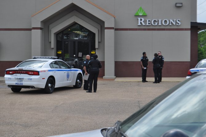 Police officers at the Regions Bank in Fondren --- North State Street.