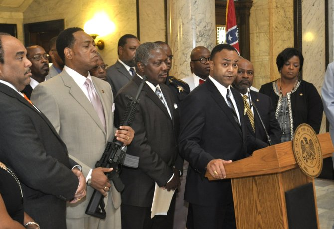 Hinds County District Attorney Robert Smith spoke out at the Mississippi Capitol today against an open carry law going into effect July 1. Legislative Black Caucus Chairman Sen. Kenneth Wayne Jones, D-Canton, displayed a semi-automatic weapon at the June 27 press conference.