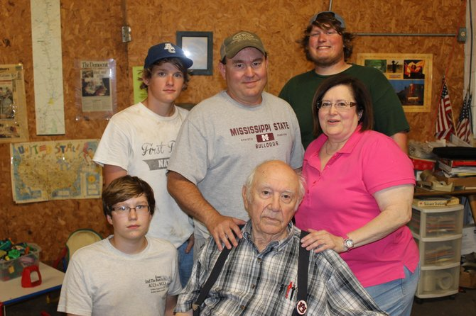 The Galbreath family (clockwise from top left: Dylan, Scott Galbreath III, Scott Galbreath IV, Diane, winery founder Scott O. Galbreath Jr. and Lane) still own and operate the Old South Winery today.