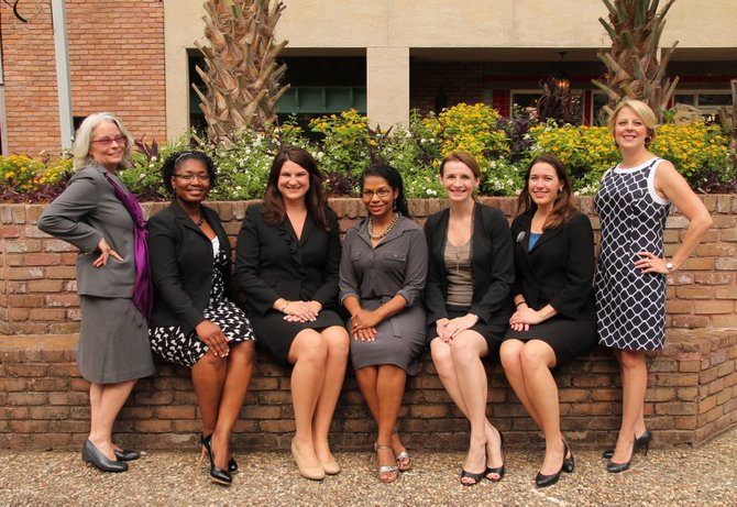 The 2013 Heroes of the Year are the members of the Women's Initiative at Baker Donelson, including (from left) Sheryl Bey, Marlena Pickering, Ashley Tullos, Kenya Rachal, Alicia Hall, Anna Powers and Amy Champagne.