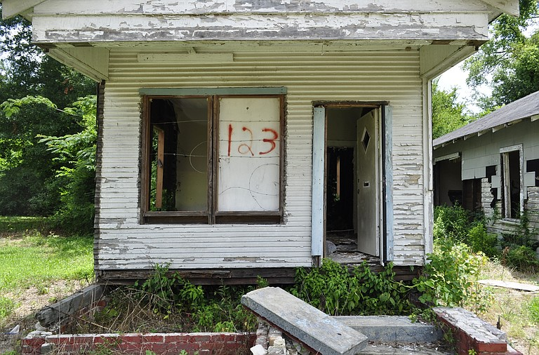 Abandoned and dilapidated houses, such as this one on Farish Street, are common in parts of Jackson and neighbors are fed up.