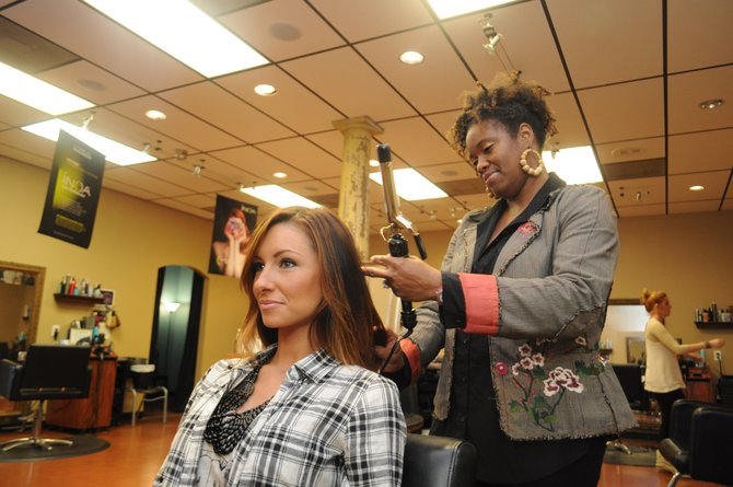 Stephanie Barnes (standing), owner of LaCru salon, recently branched out into the trendy world of dry bars.