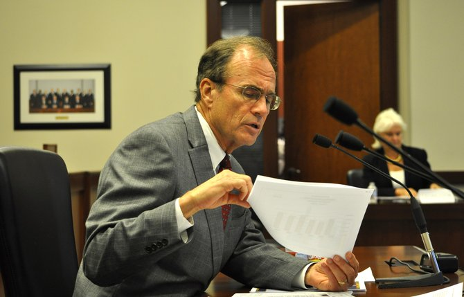 Mississippi Secretary of State Delbert Hosemann plans to have the state's voter-identification law in place by spring or summer of 2014.