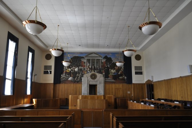 The courtroom on the fourth floor features the controversial 1938 mural on one of its walls that is one part of the James O. Eastland Federal Building that must be preserved, as mandated by the Mississippi Department of Archives and History.