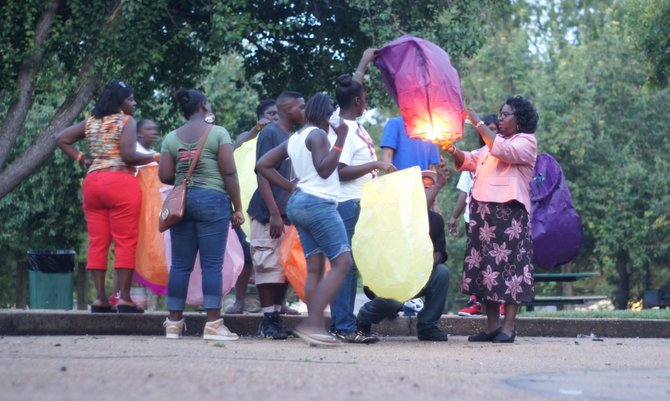 Friends and relatives of Quardious Thomas, a 20-year-old man killed this summer in Jackson, released sky lanterns in his memory.