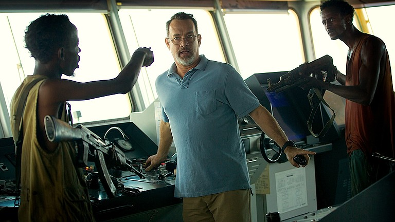 """Tom Hanks, center, stars in the new Paul Greengrass movie, """"Captain Phillips,"""" about a vessel overtaken by Somalian pirates."""