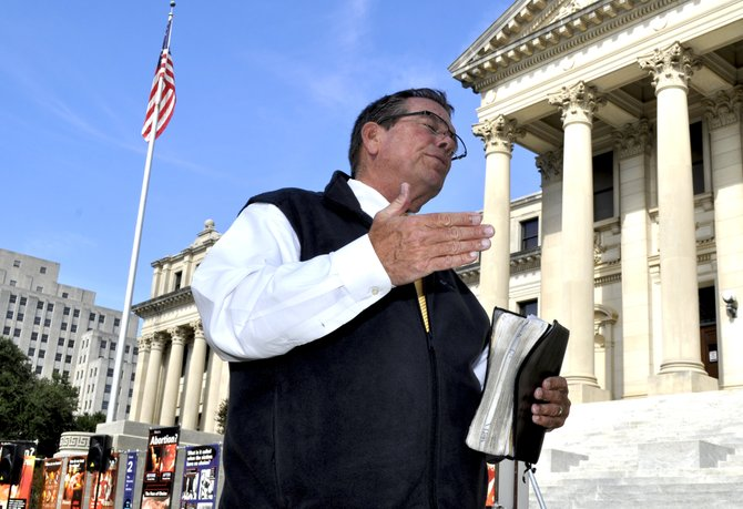 Preacher Flip Benham and his band of anti-abortion protesters from Operation Rescue America descended on Jackson Monday, two days after a pro-abortion rights rally at Jackson Women's Health Organization, or JWHO, the state's sole remaining abortion clinic.